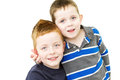 Cheeky brothers standing together on white Royalty Free Stock Image
