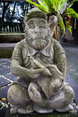 Cheeky monkey statue in bali outside of the forest Royalty Free Stock Photography