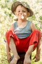 Cheeky young barefoot country boy Royalty Free Stock Photo