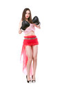 Cheeky young brunette wearing trendy clothes and boxing gloves isolated on white Stock Images