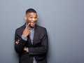 Cheerful african american business man pointing finger Royalty Free Stock Photo