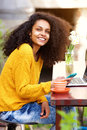 Cheerful african american lady sitting at outdoor cafe Royalty Free Stock Photo