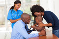 Cheerful african mother her baby son doctor s office male doctor female nurse Stock Photography