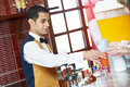 Cheerful arab barman at counter Royalty Free Stock Image