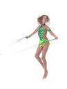Cheerful artistic gymnast jumping with rope in studio Stock Images