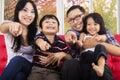 Cheerful asian family pointing at camera Royalty Free Stock Photo