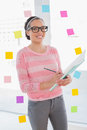 Cheerful attractive artist writing on her sketchpad in bright room Stock Photo