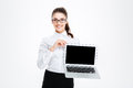 Cheerful attractive young businesswoman in glasses holding blank screen laptop Royalty Free Stock Photo