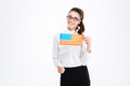 Cheerful attractive young businesswoman in glasses holding USA flag Royalty Free Stock Photo