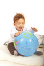 Cheerful baby with big world globe boy playing Stock Photo