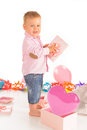 Cheerful baby boy with birthday gifts over white background Royalty Free Stock Photo
