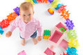 Cheerful baby boy with birthday gifts over white background Stock Image