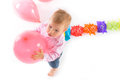 Cheerful baby boy walking with pink baloon in his hands Royalty Free Stock Photo