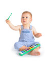 Cheerful baby boy and xylophone playing on isolated over white background Stock Image