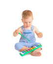 Cheerful baby boy and xylophone playing on isolated over white background Royalty Free Stock Photos