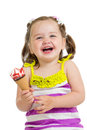 Cheerful baby girl eating ice cream isolated kid Royalty Free Stock Image
