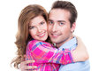 Cheerful beautiful couple in embrace looking at camera on white background Royalty Free Stock Image