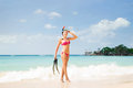 Cheerful, beautiful girl with slim body posing on the seacoast with a scuba mask Royalty Free Stock Photo