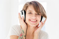 Cheerful beautiful young woman in headphones listening to music closeup portrait of over white background Royalty Free Stock Photography