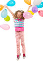 Cheerful birthday girl leaping with colorful balloons in the air usikated on white background Stock Images