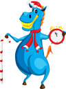 Cheerful blue horse symbol of the new year with a clock and candy Royalty Free Stock Photo