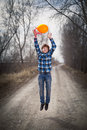 The cheerful boy with a balloon on outdoors Royalty Free Stock Photos