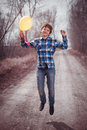 The cheerful boy with a balloon on outdoors Stock Photo