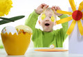 Cheerful boy and easter eggs a little in a green sweater decorated Royalty Free Stock Image