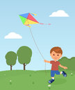 Cheerful boy enjoying flying kite Royalty Free Stock Photo