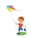 Cheerful boy enjoying flying kite. Royalty Free Stock Photo