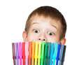 Cheerful boy with a felt-tip pen before his face Royalty Free Stock Photo
