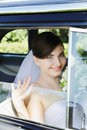 Cheerful bride sitting in the old car Stock Image