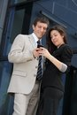 Cheerful business couple looking at a smart phone Stock Photo