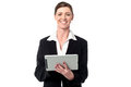 Cheerful business manager holding touch pad happy businesswoman over white Stock Images