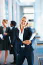 Cheerful business woman holding files Royalty Free Stock Photography