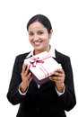 Cheerful business woman holding a gift box Royalty Free Stock Image