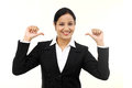 Cheerful business woman thumbs up on white Stock Photography