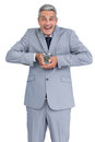 Cheerful businessman with alarm clock in both hands on white background Stock Photo