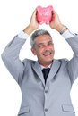 Cheerful businessman holding piggy bank above his head on white background Stock Image