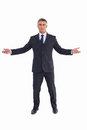 Cheerful businessman spreading his arms on white background Stock Photography