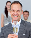 Cheerful businessman toasting with Champagne Royalty Free Stock Photos