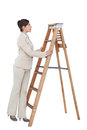 Cheerful businesswoman looking up the career ladder on white background Stock Images