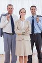 Cheerful businesswoman posing with her work team in bright office Royalty Free Stock Image