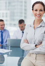 Cheerful businesswoman posing leaning against the desk Royalty Free Stock Photo