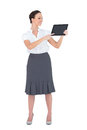 Cheerful businesswoman showing something on her tablet pc while posing white background Royalty Free Stock Photo