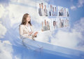Cheerful businesswoman using digital interface while cloud computing Royalty Free Stock Images