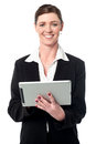 Cheerful businesswoman using tablet pc smiling female manager operating device Royalty Free Stock Images