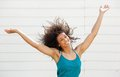 Cheerful carefree young woman portrait of a with arms raised Stock Images