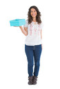 Cheerful casual brunette holding a present on white background Royalty Free Stock Photo