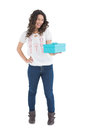 Cheerful casual brunette holding a present on white background Royalty Free Stock Image